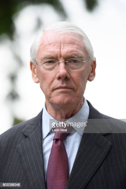 Sir Martin MooreBick leaves the Parish of St Clement church after meeting local residents on June 29 2017 in London England The retired Court of...