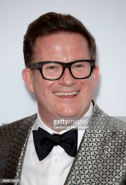 Sir Matthew Bourne winner of the Best Theatre Choreographer award for 'The Red Shoes' poses in the winners room at The Olivier Awards 2017 at Royal...