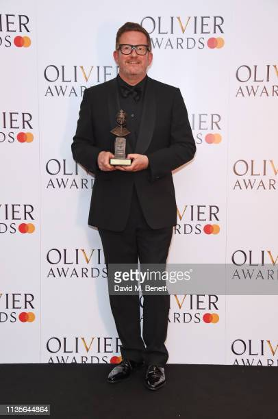 Sir Matthew Bourne winner of the Special Award poses in the press room at The Olivier Awards 2019 with Mastercard at The Royal Albert Hall on April 7...