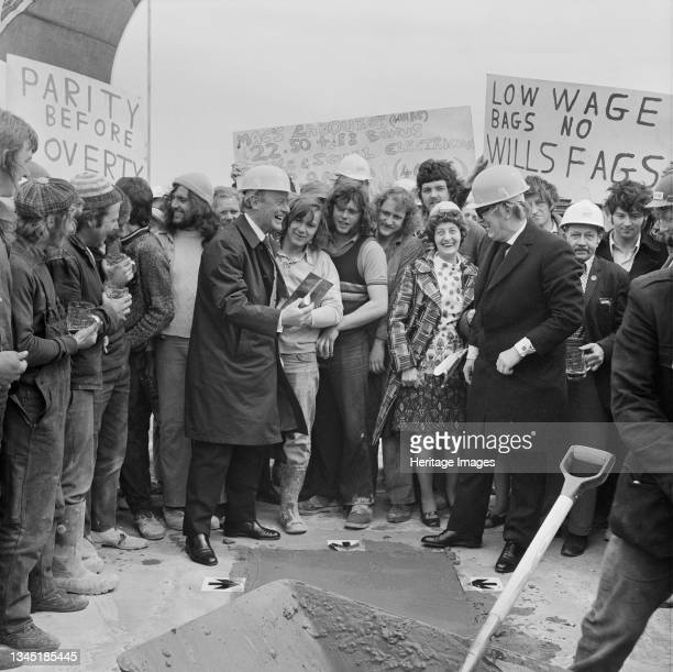 Sir Maurice Laing at the topping out ceremony on the roof of the office building at the Wills tobacco factory at Hartcliffe, a packet of Embassy...