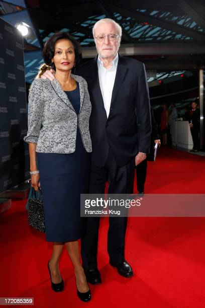 Sir Michael Caine and his wife Shakira Caine attend the Munich Film Festival 2013 - Cine Merit Award 2013 at BMW World on July 01, 2013 in Munich,...
