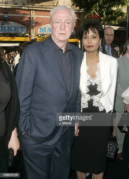 "Sir Michael Caine and wife Shakira Caine during ""Batman Begins"" Los Angeles Premiere - Arrivals at Grauman's Chinese Theater in Hollywood,..."