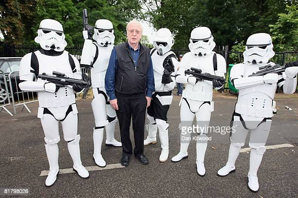 Sir Michael Caine poses with Storm Troopers at 'The Amazing Great Children's Party' in Battersea Park on July 2 2008 in London England