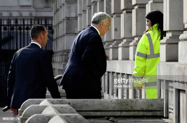Sir Michael Fallon arrives with a close protection officer at the Cabinet Office on November 1 2017 in London United Kingdom Sir Michael Fallon...