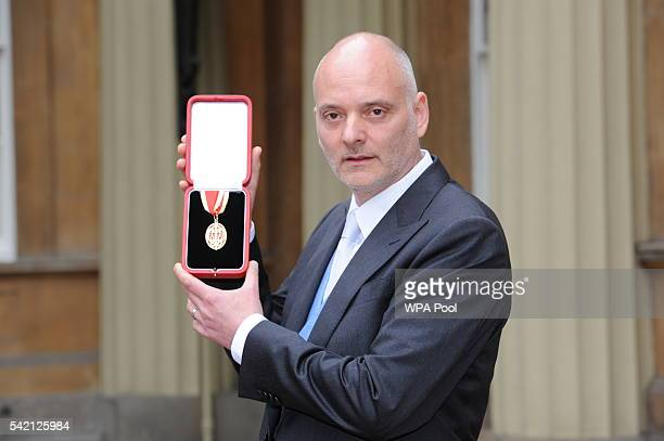 Sir Michael Jacobs poses after he was made a Knight Bachelor by the Princess Royal during an investiture ceremony at Buckingham Palace on June 22...