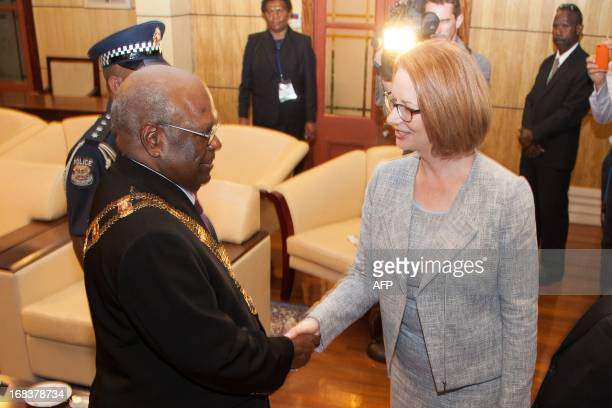 Sir Michael Ogio the Governor General of Papua New Guinea welcomes Australian Prime Minister Julia Gillard at the Government House in Port Moresby...
