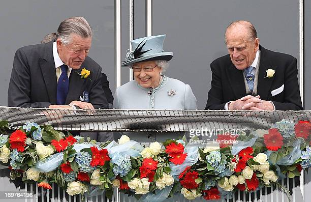 Sir Michael Oswald, Queen Elizabeth ll and Prince Philip, Duke of Edinburgh watch the Investec Derby on Derby Day at The Derby Festival on June 1,...