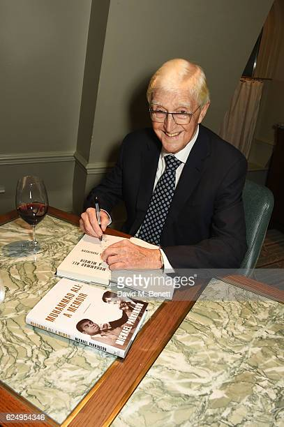 Sir Michael Parkinson signs copies of his new book 'Muhammad Ali A Memoir' at Fortnum Mason on November 21 2016 in London England