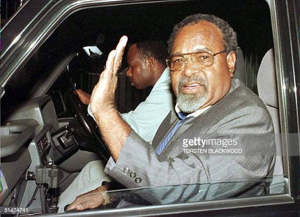 Sir Michael Somare The Father Of The Nation waves as he leaves the PNG Parliament in Port Moresby 24 March after a hectic day of behindthescenes...