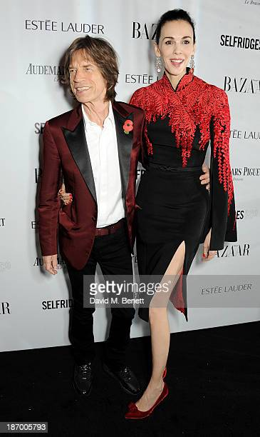 Sir Mick Jagger and L'Wren Scott arrive at the Harper's Bazaar Women of the Year awards at Claridge's Hotel on November 5 2013 in London England