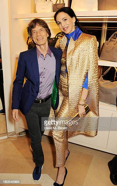 Sir Mick Jagger and L'Wren Scott attend the launch of the Longchamp London flagship store on September 14, 2013 in London, England.