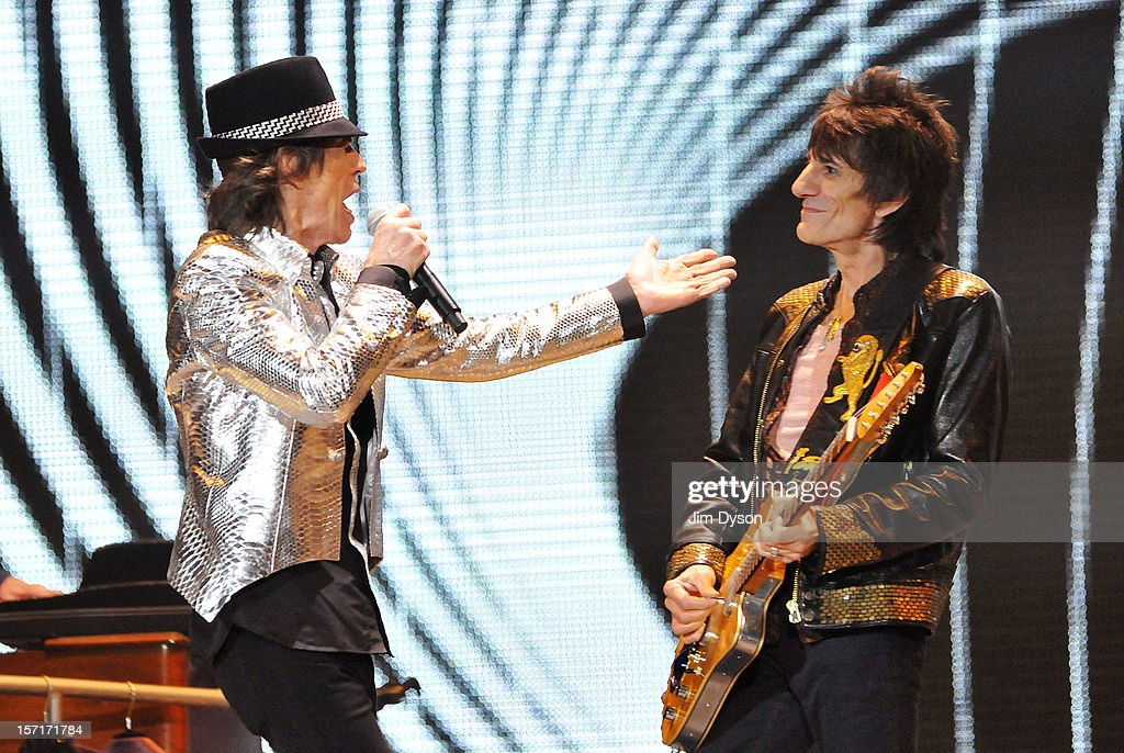 Sir Mick Jagger and Ronnie Wood of The Rolling Stones perform live on stage, during their 50th anniversary tour at O2 Arena on November 29, 2012 in London, England.
