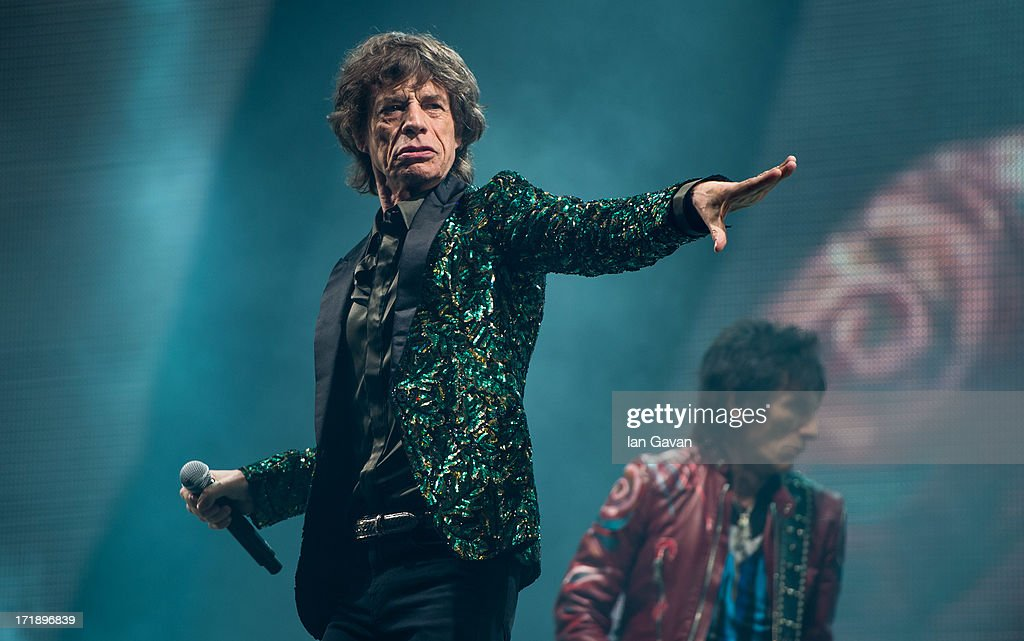 Sir Mick Jagger and Ronnie Wood of The Rolling Stones perform on the Pyramid Stage during day 3 of the 2013 Glastonbury Festival at Worthy Farm on June 29, 2013 in Glastonbury, England.