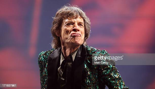 Sir Mick Jagger of The Rolling Stones performs on the Pyramid Stage at Glastonbury Festival 2013 on June 29, 2013 in Glastonbury, England. At the...