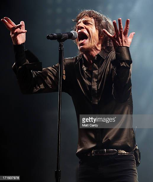 Sir Mick Jagger of The Rolling Stones performs on the Pyramid Stage at Glastonbury Festival 2013 on June 29 2013 in Glastonbury England at the...