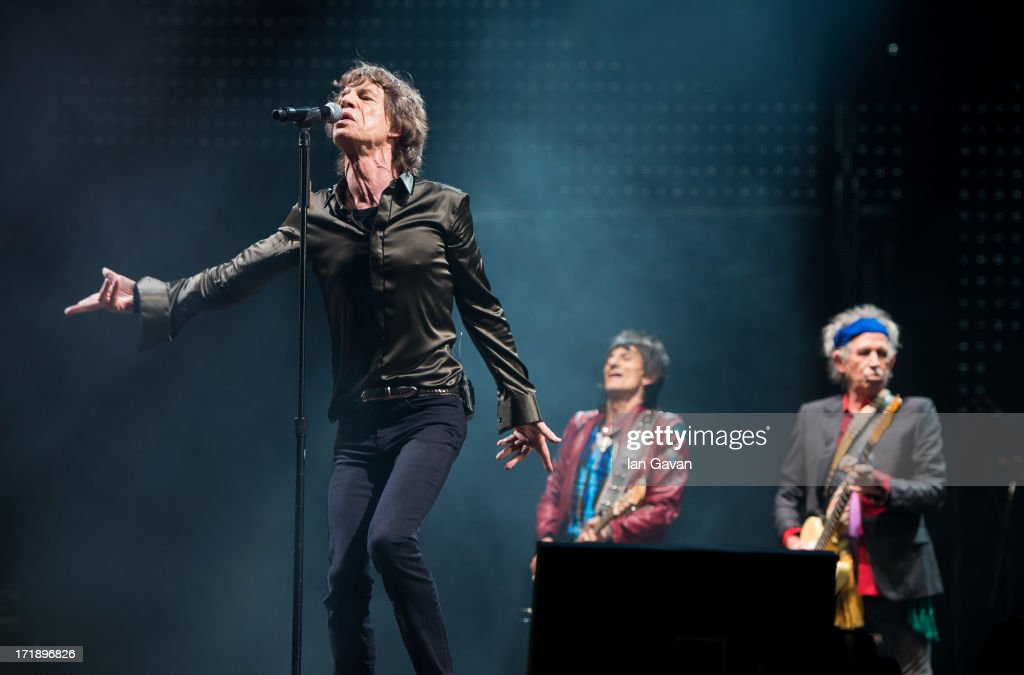Sir Mick Jagger, Ronnie Wood and Keith Richards of The Rolling Stones perform on the Pyramid Stage during day 3 of the 2013 Glastonbury Festival at Worthy Farm on June 29, 2013 in Glastonbury, England.