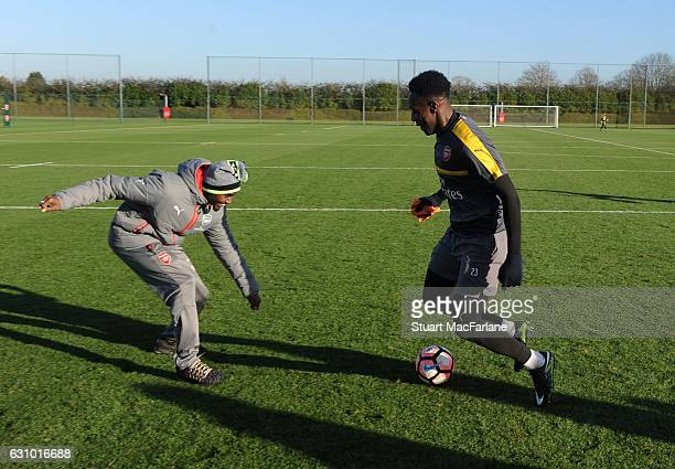 Sir Mo Farah competes with Arsenal Arsenal's Danny Welbeck after watching a training session at London Colney on January 5, 2017 in St Albans,...