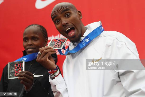 Sir Mo Farah of Great Britain celebrates winning the men's race setting a new European record in 2 hoursfive minutes and 11 seconds alongside Brigid...