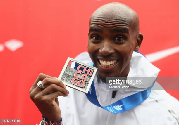 Sir Mo Farah of Great Britain celebrates winning the men's race setting a new European record in 2 hoursfive minutes and 11 seconds during the 2018...