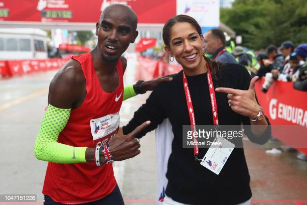 Sir Mo Farah of Great Britain celebrates winning the men's race setting a new European record in 2 hoursfive minutes and 11 seconds alongside his...