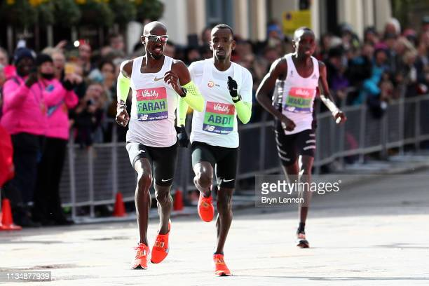 Sir Mo Farah of Great Britain kicks for the finish line on his way to winning the men's Vitality Big Half on March 10 2019 in London England