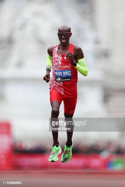 Sir Mo Farah of Great Britain runs towards the finish line during the Men's Elite race during the Virgin Money London Marathon at United Kingdom on...