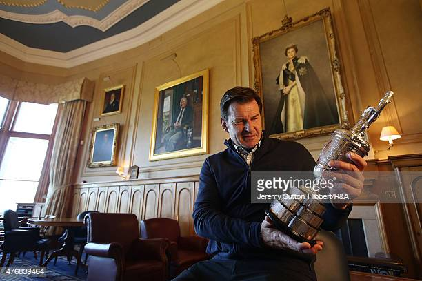 Sir Nick Faldo golfer and three times winner of the Open Championship with his Open Championship winner's Claret Jug in the Big Room of the Royal And...