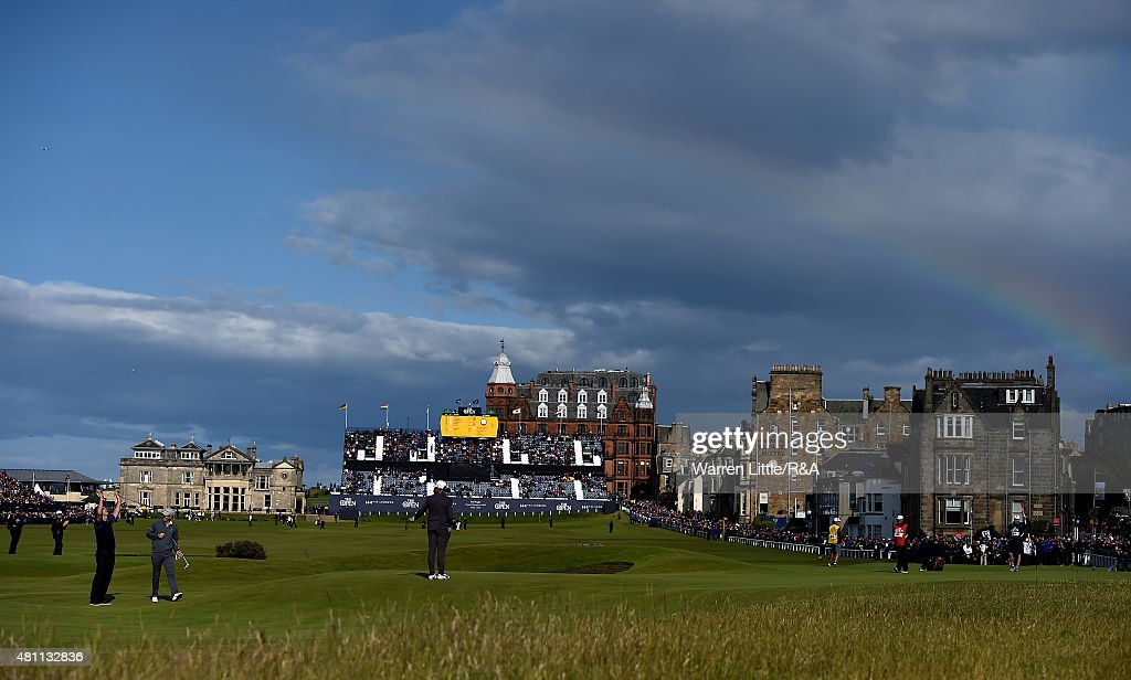Sir Nick Faldo of England celebrates his putt for birdie on the 17th green as a rainbow is seen in the distance during the second round of the 144th Open Championship at The Old Course on July 17, 2015 in St Andrews, Scotland.
