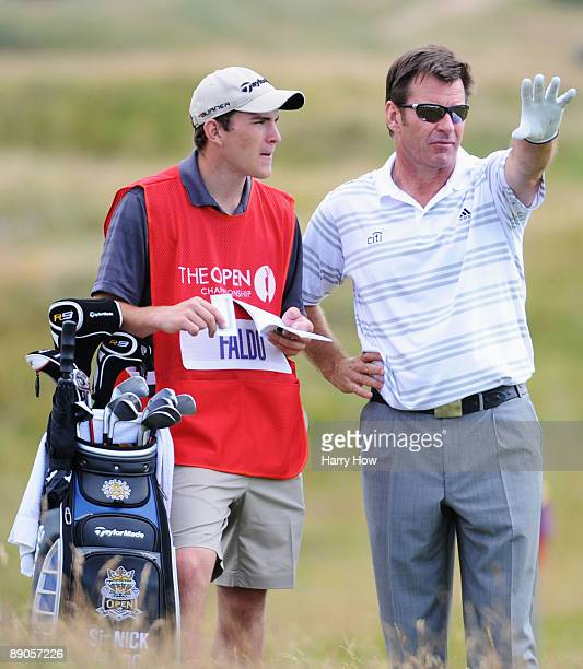 Sir Nick Faldo of England lines up a shot with his caddy/son Matthew on the 8th hole during round one of the 138th Open Championship on the Ailsa...