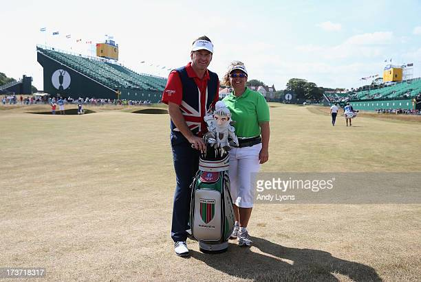 Sir Nick Faldo of England poses with former caddie Fanny Sunesson ahead of the 142nd Open Championship at Muirfield on July 17 2013 in Gullane...