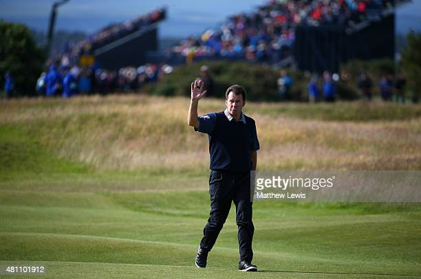 Sir Nick Faldo of England waves to the crowd as he walks along the 17th hole fairway during the second round of the 144th Open Championship at The...