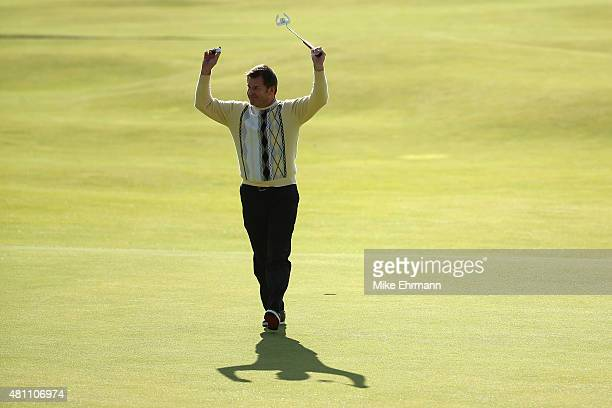 Sir Nick Faldo of England waves to the crowd on the 18th green during the second round of the 144th Open Championship at The Old Course on July 17...