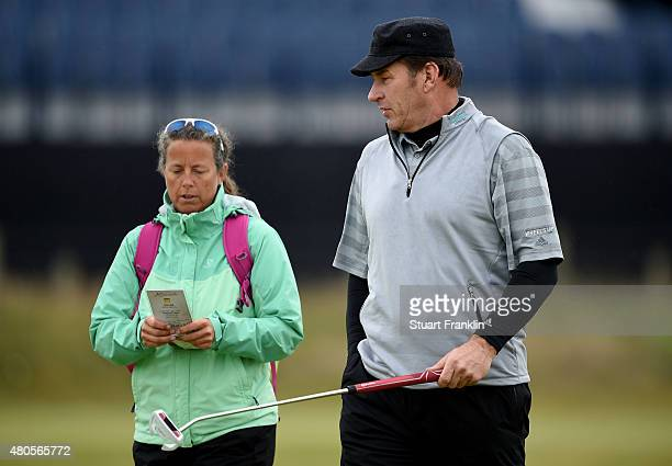 Sir Nick Faldo talks with former caddie Fanny Sunesson as he plays a practice round ahead of the 144th Open Championship at The Old Course on July 13...