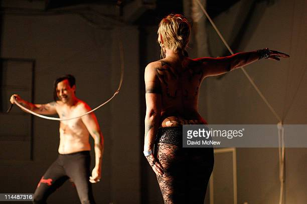Sir Nik Satanas uses a whip on a woman at an offsite dungeon party during the 8th annual DomCon LA convention on May 20 2011 in Los Angeles...
