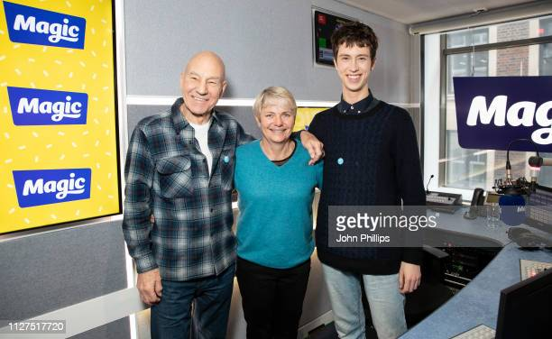 Sir Patrick Stewart and Angus Imrie pose with presenter Alice Arnold during a visit to Magic Radio on February 05 2019 in London England