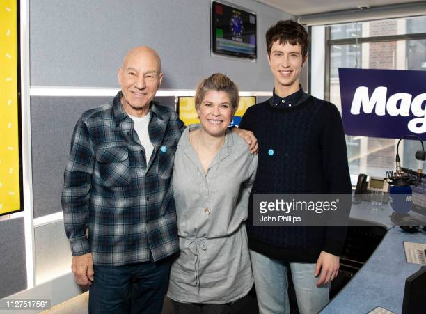 Sir Patrick Stewart and Angus Imrie pose with presenter Emma B during a visit Magic Radio on February 05 2019 in London England