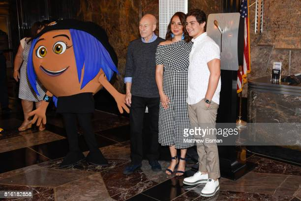 Sir Patrick Stewart Maya Rudolph and Jake T Austin of the film The Emoji Movie pose together for a photo to celebrate World Emoji Day at The Empire...