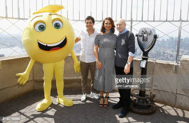 Sir Patrick Stewart Maya Rudolph and Jake T Austin pose as 'The Emoji Movie' celebrates World Emoji Day at Empire State Building at The Empire State...