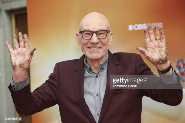 Sir Patrick Stewart places his handprints and footprints in cement At TCL Chinese Theatre IMAX on January 13, 2020 in Hollywood, California.