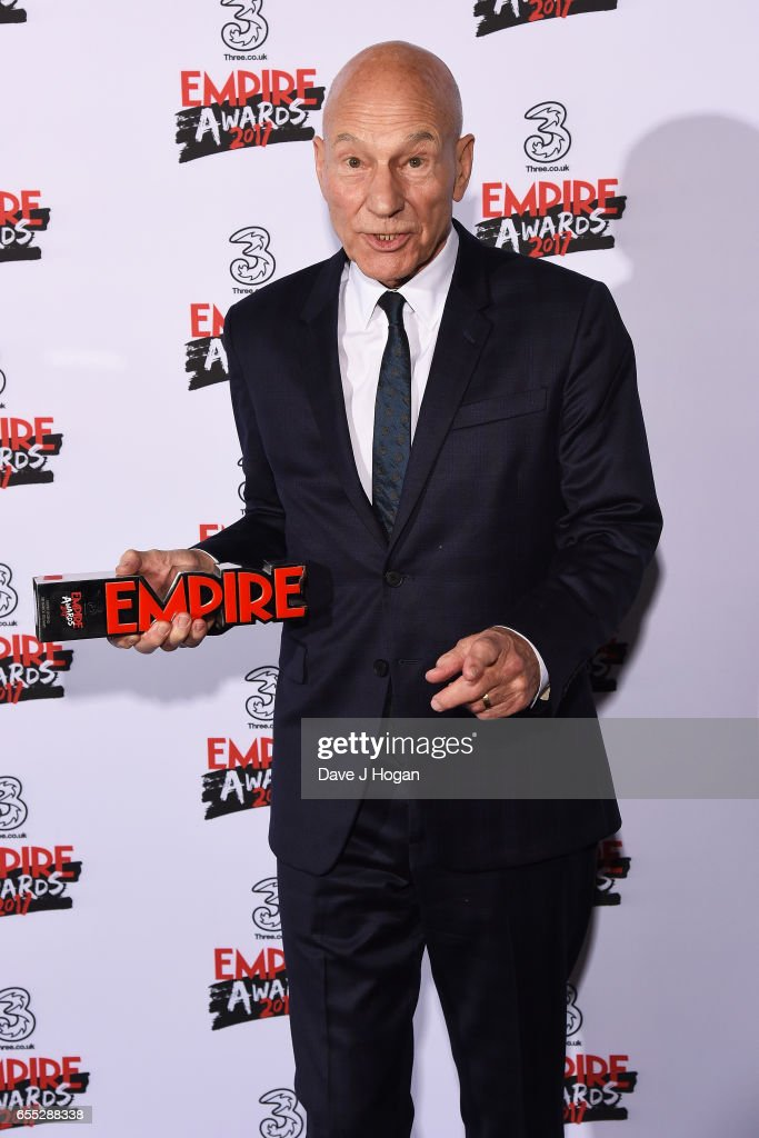 Sir Patrick Stewart poses with the award for Empire Legend in the winners room at the THREE Empire awards at The Roundhouse on March 19, 2017 in London, England.