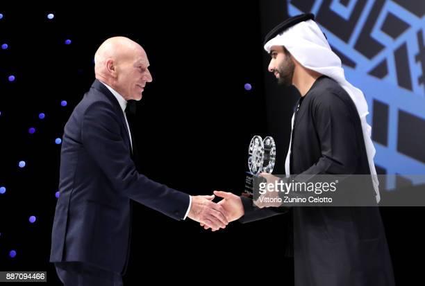 Sir Patrick Stewart receives the Lifetime Achievement Award on stage from HH Sheikh Mansoor bin Mohammed bin Rashid Al Maktoum during the Opening...