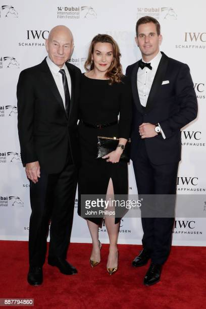 Sir Patrick Stewart, Sunny Ozell and IWC Schaffhausen CEO Christoph Grainger-Herr attend the sixth IWC Filmmaker Award gala dinner at the 14th Dubai...
