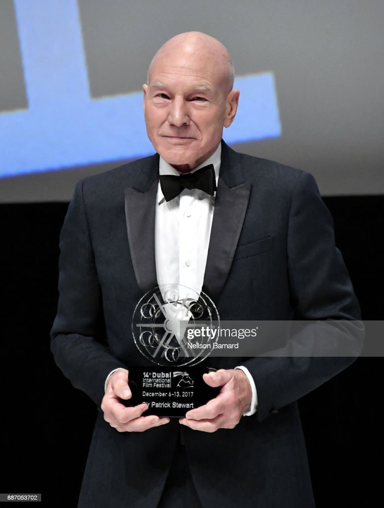 Sir Patrick Stewart with his Lifetime Achievement Award on stage during the Opening Night Gala of the 14th annual Dubai International Film Festival held at the Madinat Jumeriah Complex on December 6, 2017 in Dubai, United Arab Emirates.
