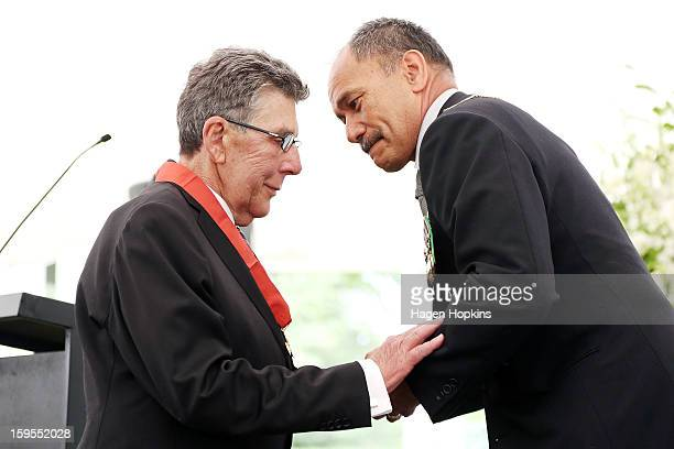 Sir Paul Holmes shakes hands with GovernorGeneral Sir Jerry Mateparae after receiving a Knighthood in recognition of his services to broadcasting and...