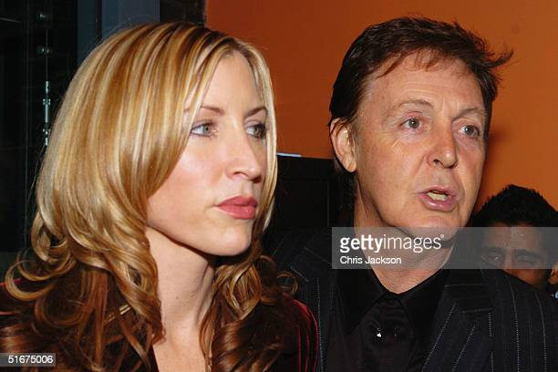 Sir Paul McCartney and Heather Mills attend the Each One Believing Private View of photos by US photographer Bill Bernstein of McCartney taken during...