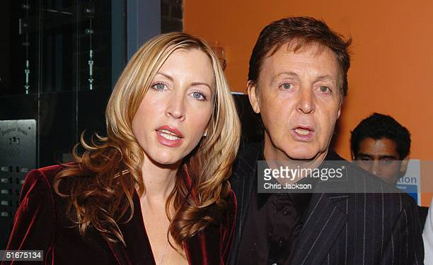 Sir Paul McCartney and Heather Mills attend the 'Each One Believing' Private View of photos by US photographer Bill Bernstein of McCartney taken...