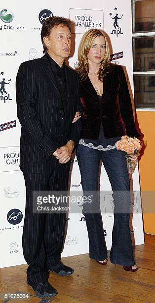 Sir Paul McCartney and Heather Mills McCartney attend the 'Each One Believing ' Private View of photos by US photographer Bill Bernstein of Sir Paul...