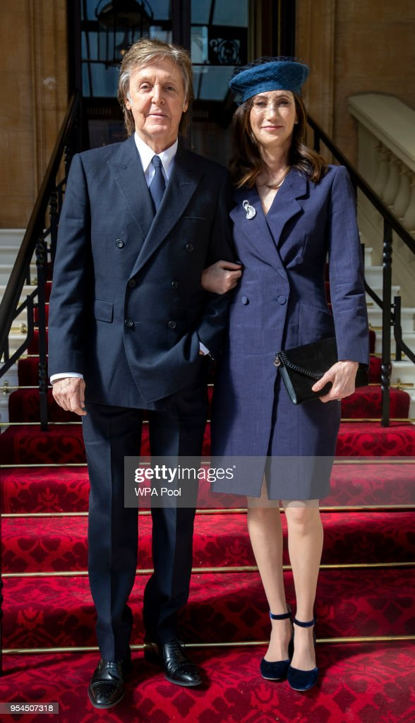Sir Paul McCartney and his wife Nancy Shevell arrive for his Investiture, where he will be made a Companion of Honour at Buckingham Palace on May 4, 2018 in London, England.