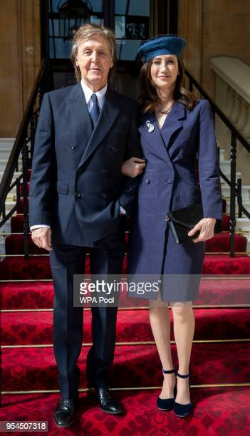 Sir Paul McCartney and his wife Nancy Shevell arrive for his Investiture where he will be made a Companion of Honour at Buckingham Palace on May 4...