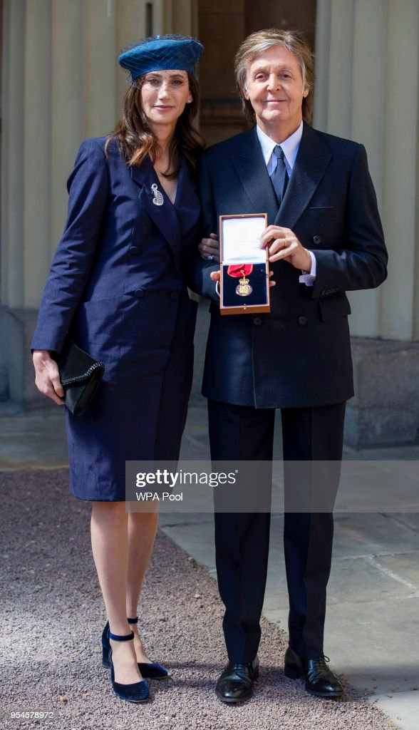 Sir Paul McCartney and his wife Nancy Shevell following an Investiture ceremony, where he was made a Companion of Honour at Buckingham Palace on May 4, 2018 in London, England.